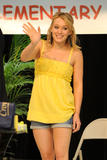 Hilary Duff shows her legs in short denim shorts and celavage in yellow top at Blessings in a Backpack event in Boca Raton