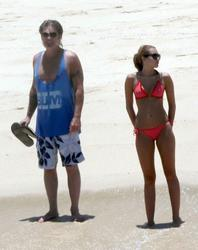 Miley Cyrus in pink bikini on a beach in Mexico - Hot Celebs Home